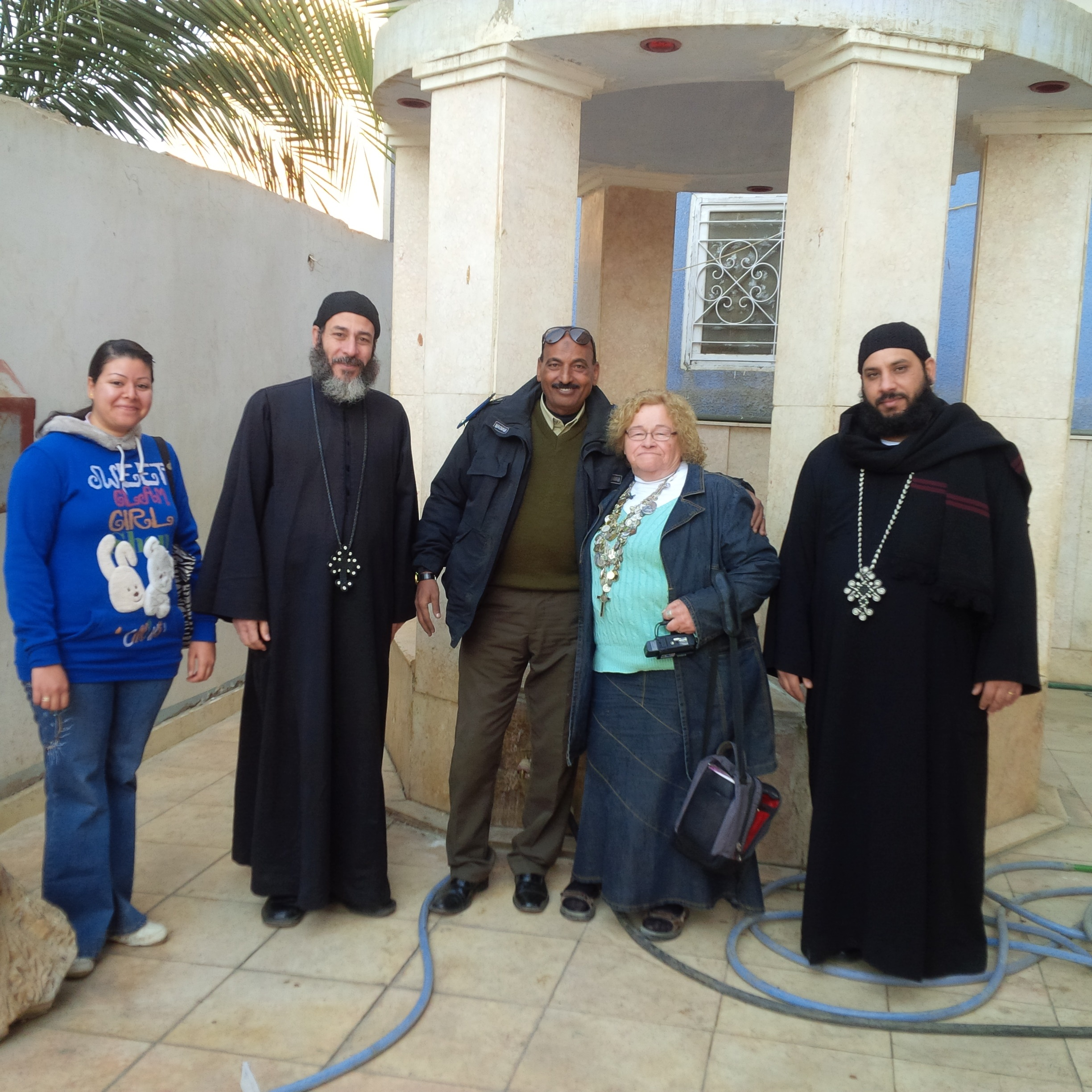 Friend, Priests AND SECURITY by the well in Church Courtyard. Our Lady had Jesus get water.