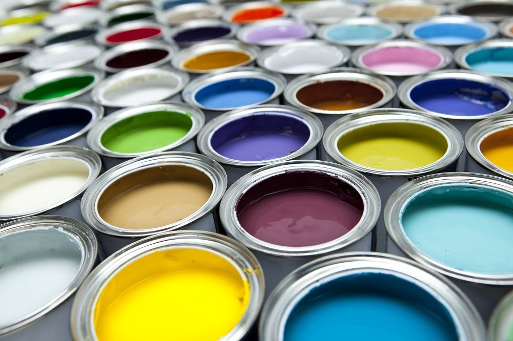 An assortment of cans of different colored satin sheen paint