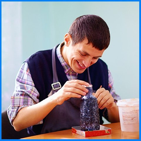 Young Adult Man With Disability Engaged in Craftsmanship