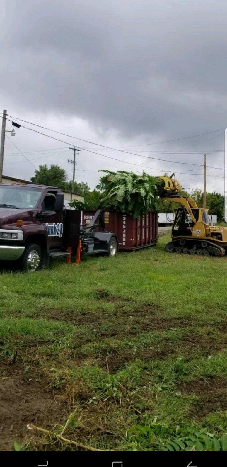 Junk2B dumpsters with loader