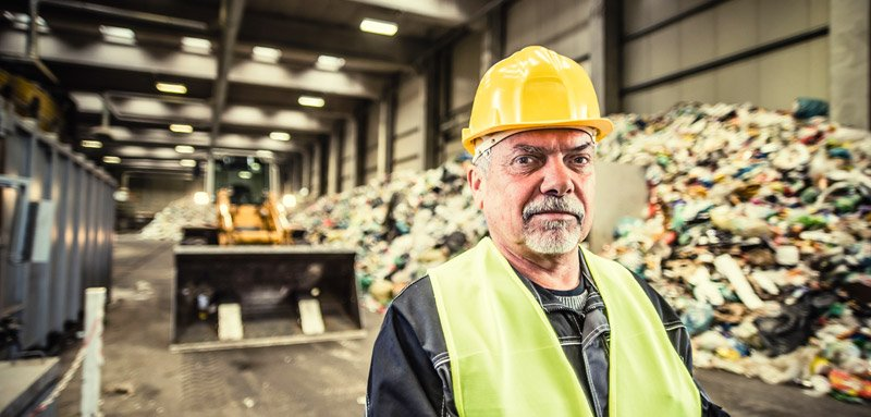 Worker at the garbage dump