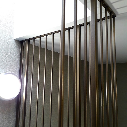 Brass coating on Cambridge hotel staircase balustrading.
