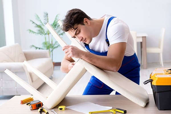 Man Repairing chair