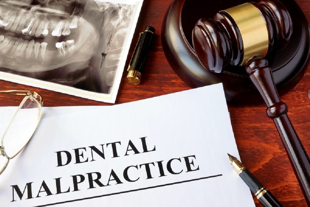 Dental malpractice paper and gavel