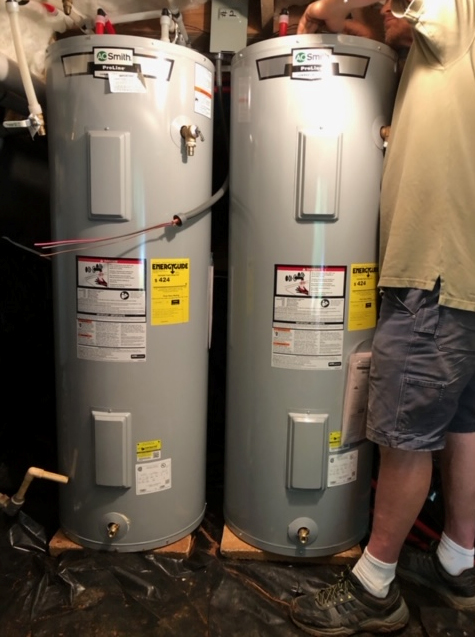 A Southern Phoenix Services employee performing maintenance on a client's water heater.