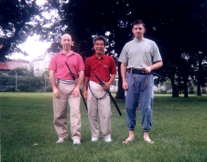 Sagamihara Family Housing, Camp Zama, Japan, 1994. From L to R: Power Sensei, Sato Masaji, Pat Cassidy. Pat was training in Toyama Ryu at the Tenman-gu Shrine in Machida City, Japan.