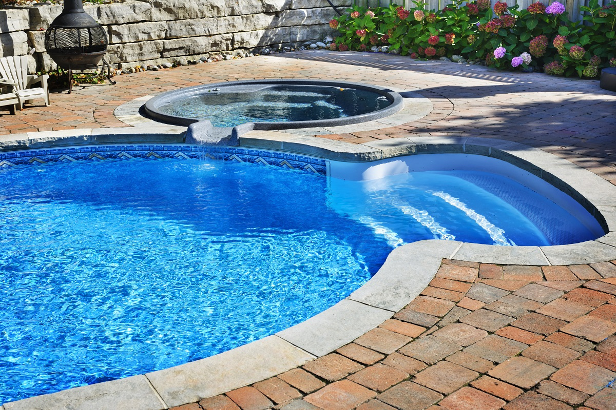 Swimming Pool with Steps and Hot Tub Nearby