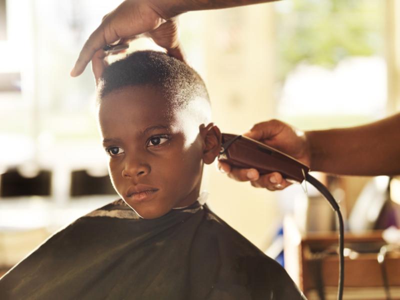 Boy in barber shop