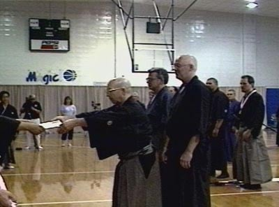 2nd Annual Orlando Taikai 2001. Kata -- 4th dan and above: 1. Guy Power (receiving certificate), 2. Kim Taylor, 3. Carl McClafferty (credit: Orlando Dojo).