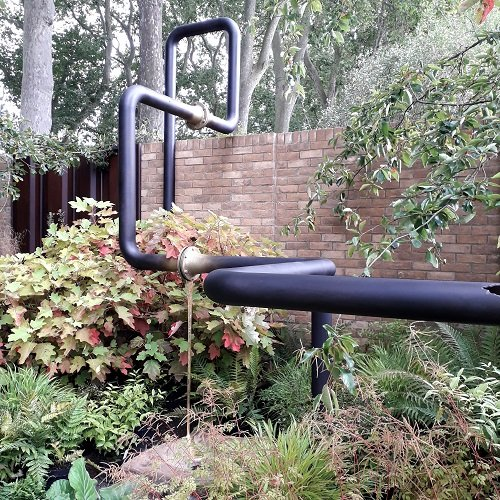 Chelsea Flower Show 2021 Artistic Metals brass metal finishing on pipework in the M&G Harris Bugg garden.