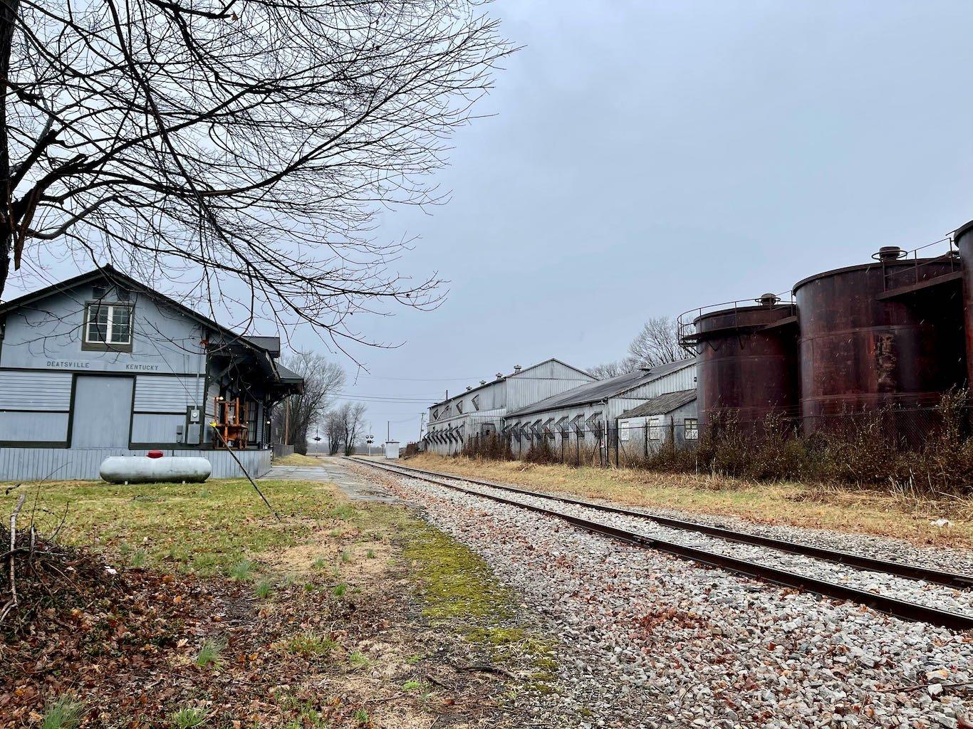 Train Depot and Outside Fermenters - Old Samuels Distillery