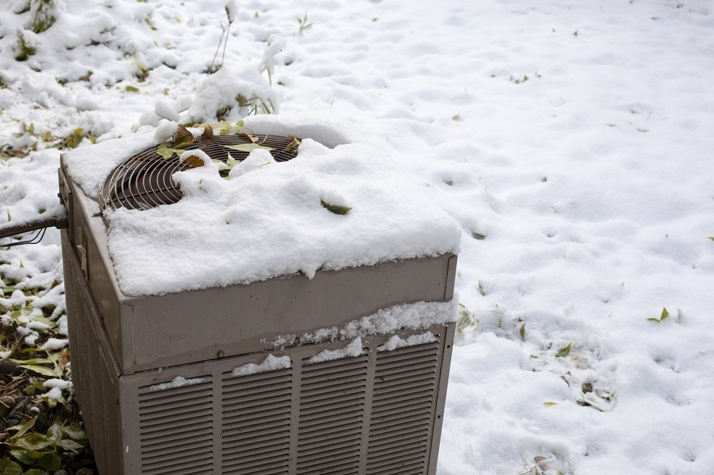 Snow covered AC unit