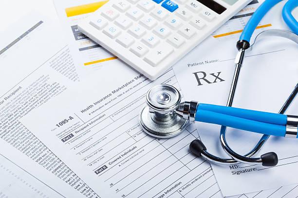 https://0201.nccdn.net/4_2/000/000/00f/745/health-care-costs-stethoscope-calculator-450w-438379591-612x408-612x408
