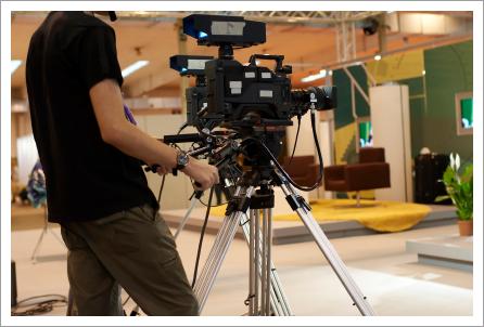 Camera operator in studio||||