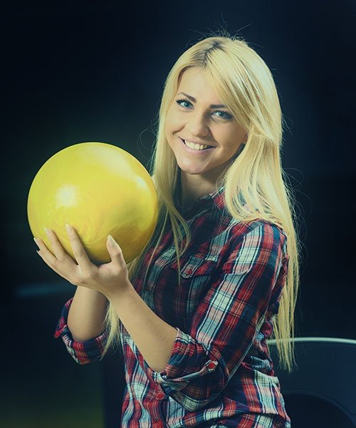 Women Holding A Bowling Ball