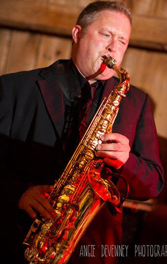 Darren Whitney on sax, the icing on the cake (photo by A. Devenney)