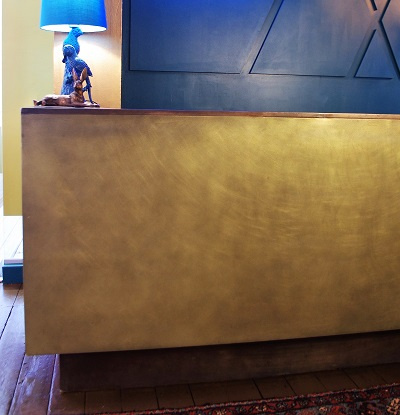 Metal coating projects - bronze & brass reception desk.