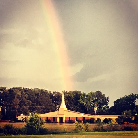 Church with rainbow over it.
