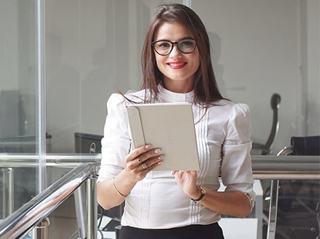 Beautiful Businesswoman Stands in Office Building