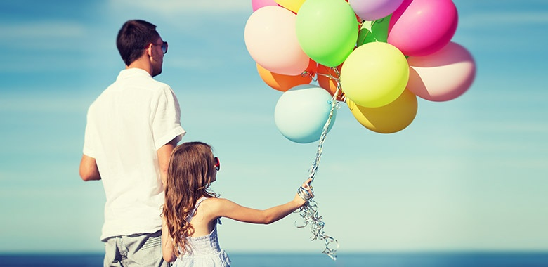 Father and Daughter With Colorful Balloons