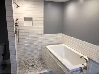 Installed custom walk in shower with drop in soaking tub adding open beauty and comfort bathing. Moreover, we incorporated large subway tiles with marble and stone rendering a modern/contemporary finish.