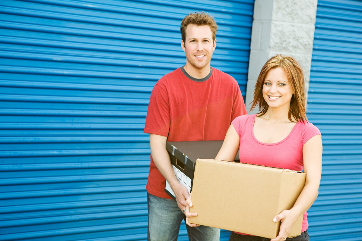 Couple putting items in self storage