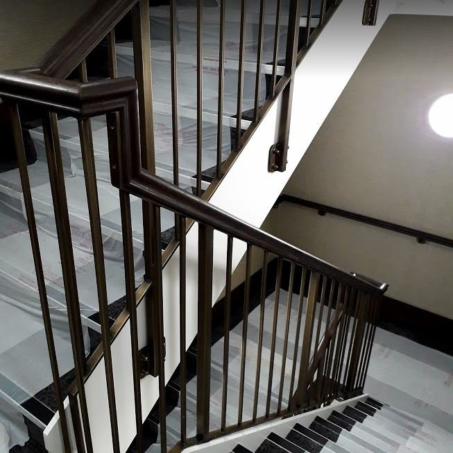 Aged brass finishing within a new Cambridge hotel. Three staircases & four floors.