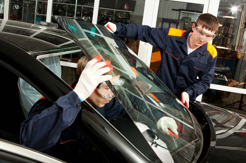 Mechanics fixing car glass