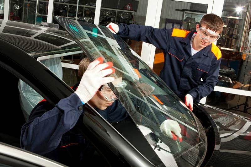 Mechanics fixing car glass