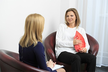 Counselor Interacting With Woman