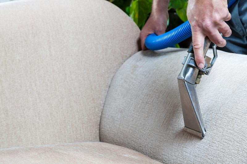 Man cleaning upholstery