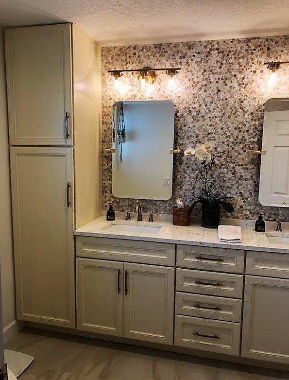 Showcasing a large bathroom utility closet for extra storage.