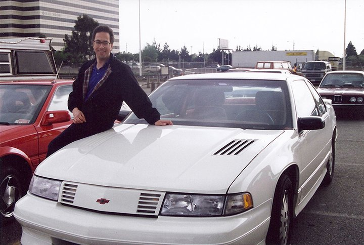 Auto writer Steve Schaefer poses with the ninth car he reviewed 25 years ago.