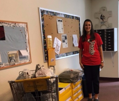 Westivew donated over 400 notebooks and pencils to Travis School. This is Emily, the counselor at Travis picking up the supplies. Thank you church members!