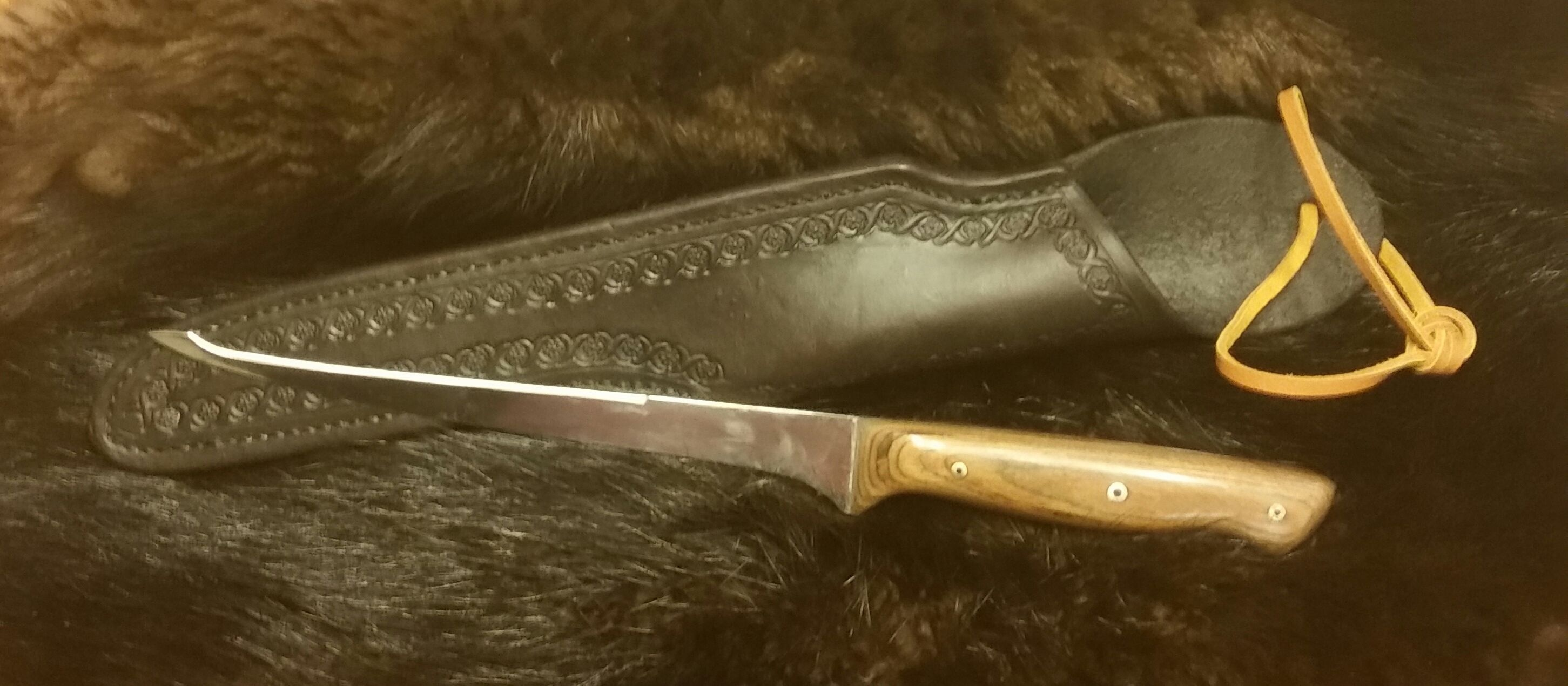Double Edge Filet Knife with Hand Tooled, Hand Stitched Leather Sheath...  $110.00