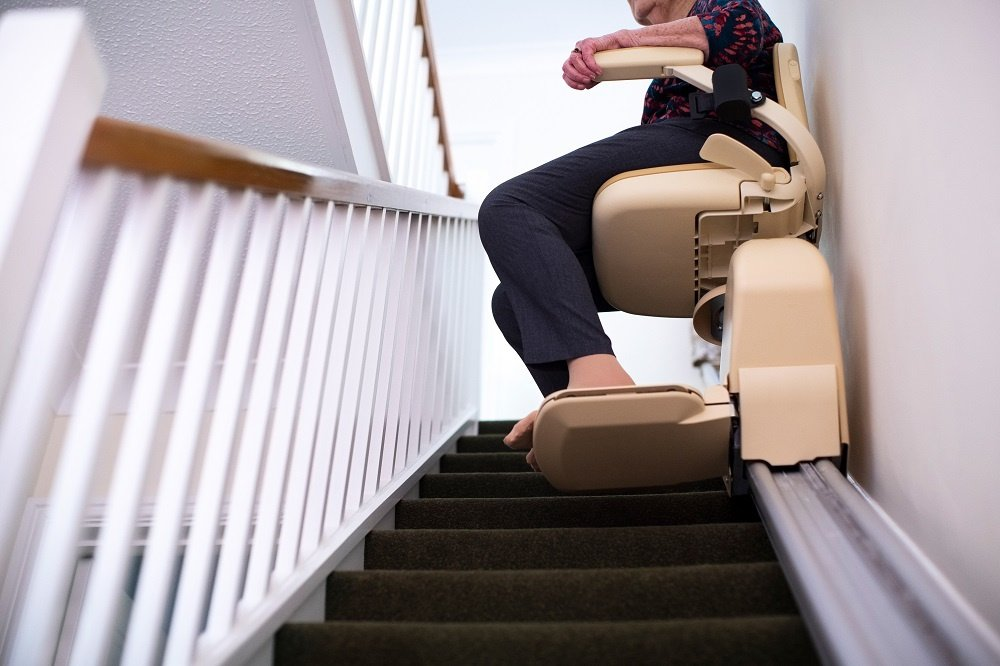 Senior Woman Sitting on Stairlift