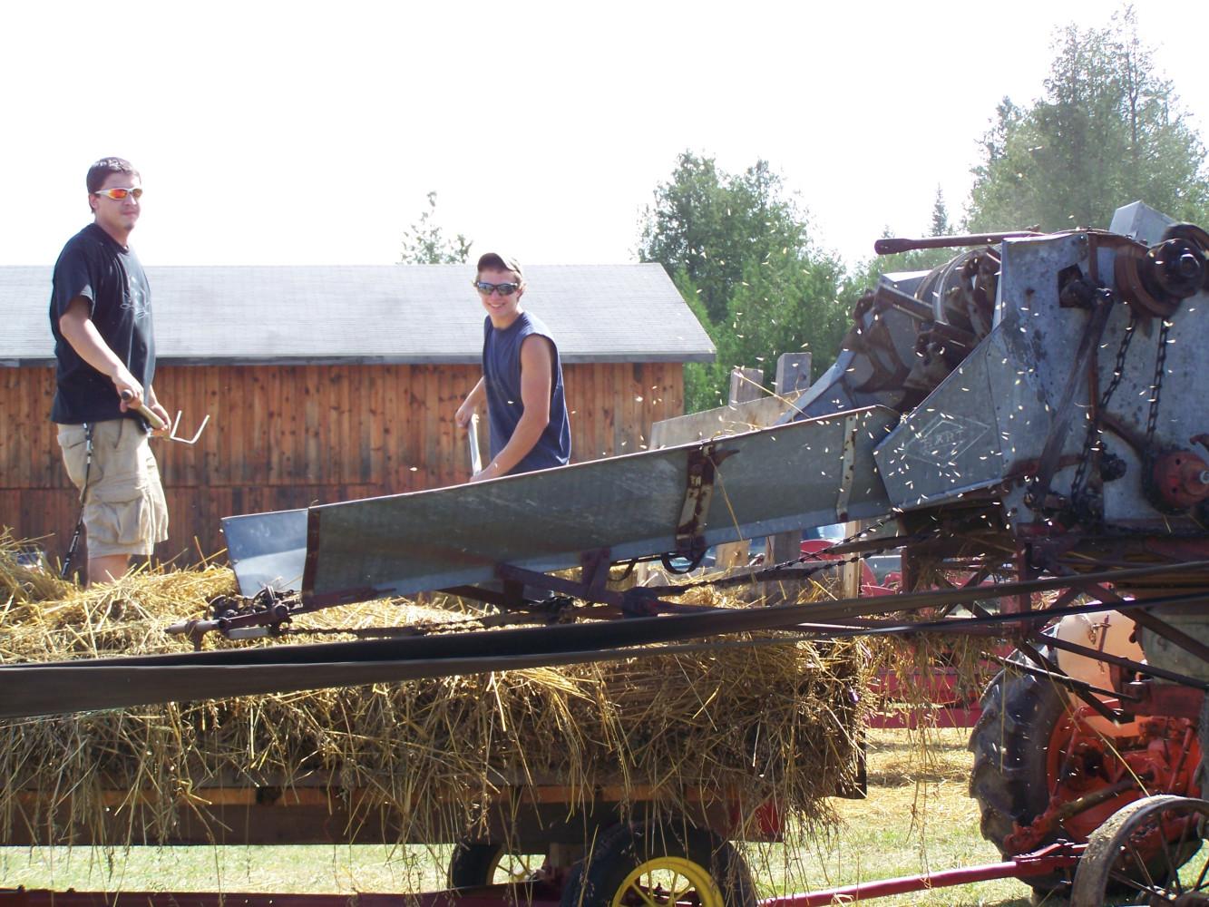 Ryan & Ethan feeding the thresher