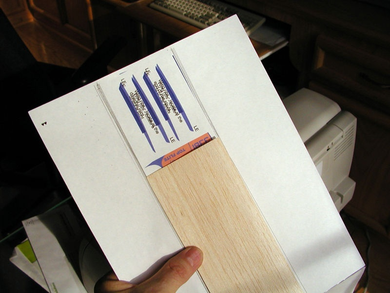 Once you have a backing sheet created with a copy of your graphic printed as a guide, align a sheet of balsa in the middle of the target printing path.