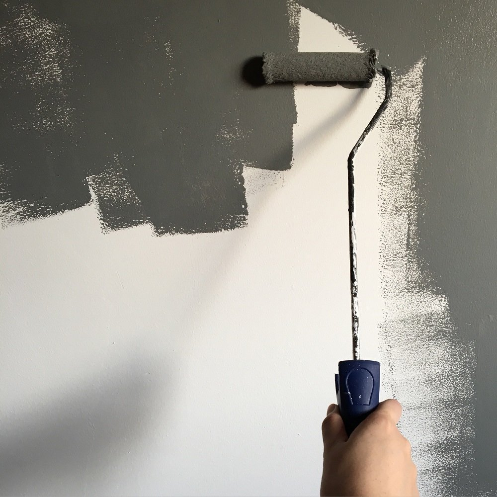 Paint Roller on Exterior Wall