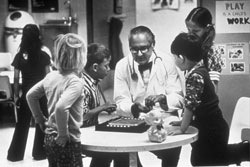 Dr. C Henry Kempe treating children at The Kempe Center in Denver (provided by The Kempe Foundation) Children's photo provided by the Kempe Foundation