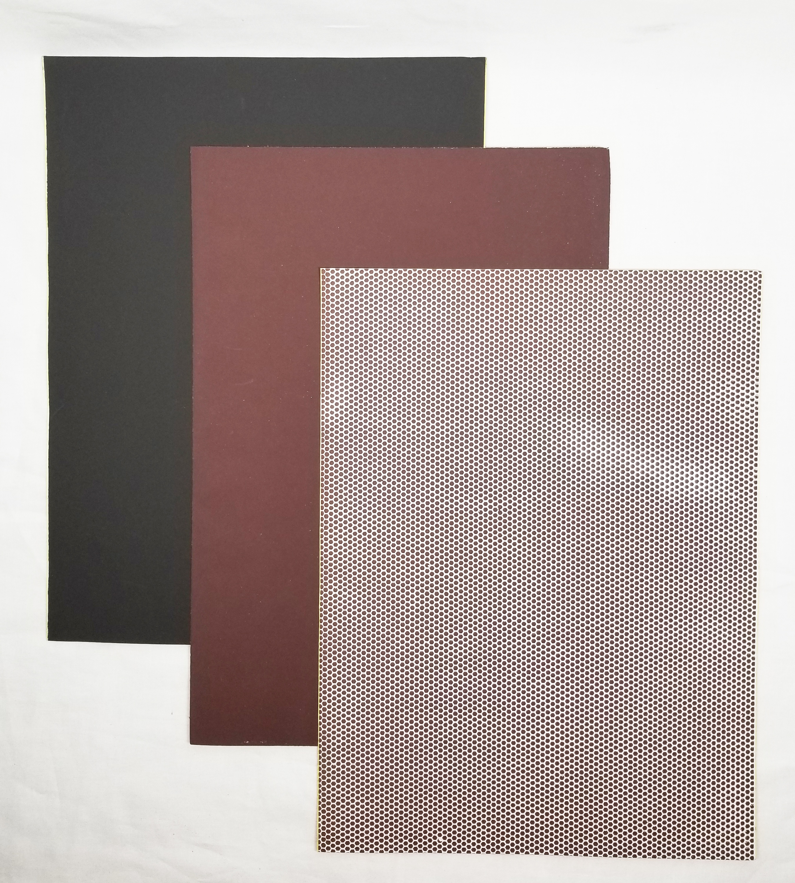 Match strike paper in 3 colors - dark gray, brown, and honeycomb pattern (dotted)