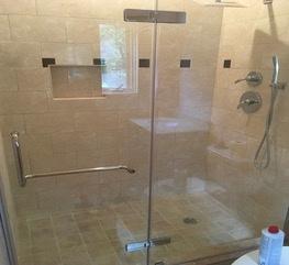 Guest bedroom custom built walk in shower with glass doors.