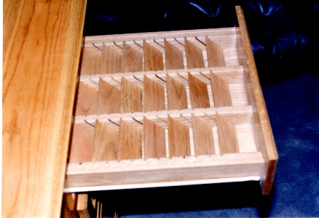 Drawer has adjustable  dividers for computer storage discs.