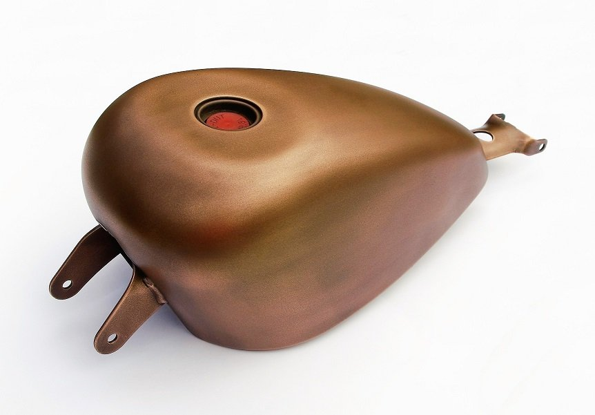 Thermal metal finishes. Antique bronze finished bike tank. Artistic Metals.