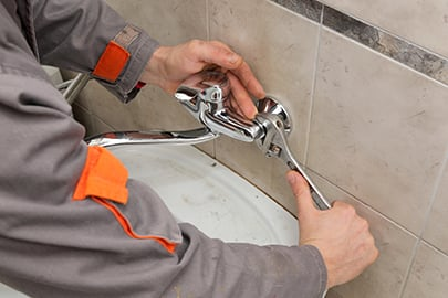 Plumber Fixing Water Tap