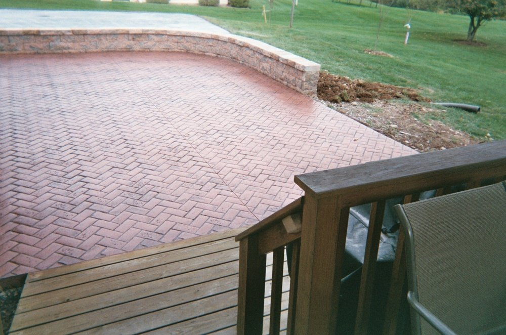 Herringbone brick patio with retaining wall