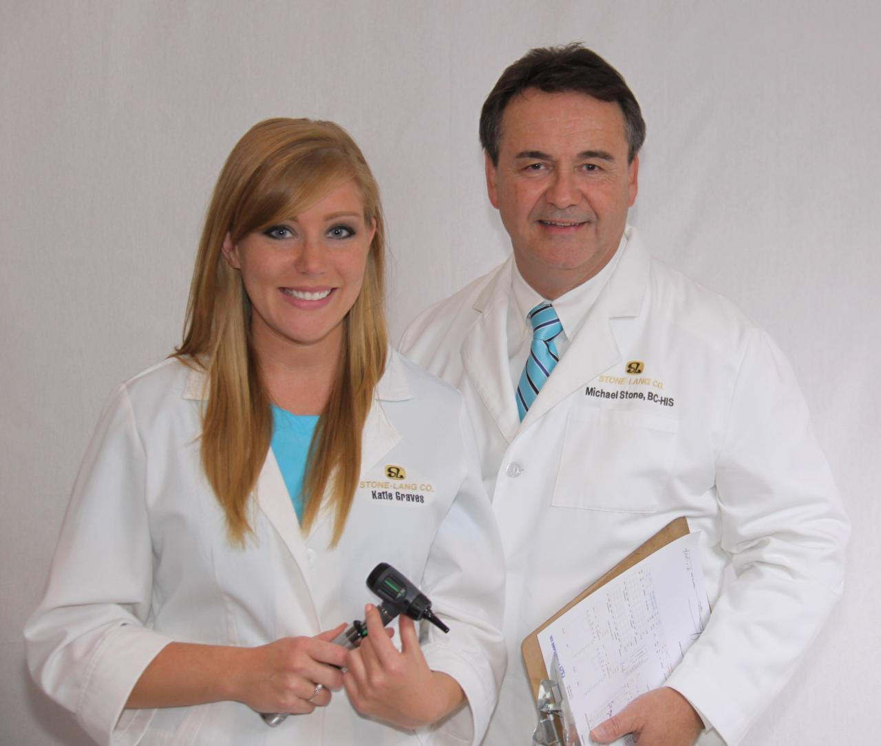 Audiologist And Her Patient With Hearing Aid