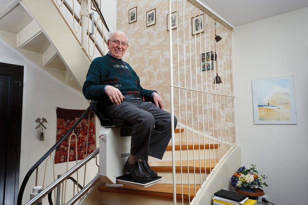 Elderly gentleman on a stairlift