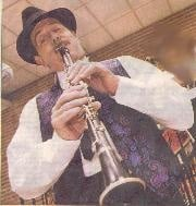 Langford playing clarinet at Jewish synagogue
