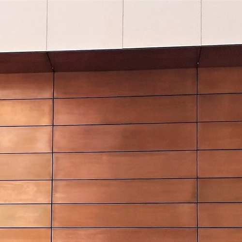 Metal coating projects. Bronze patination on cladding for Crossrail Liverpool Street Station.